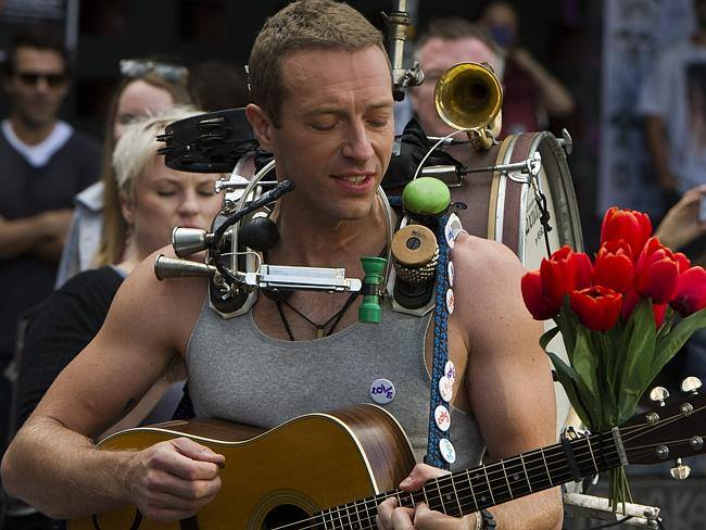 Chris Martin Remembers to Pause & Love on the Streets of Newton