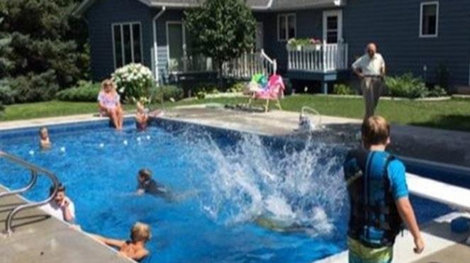 Kids swim in Keith Davidson's pool